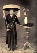 "1800's Northern Vietnamese woman dressed in Ao Tu Than, with the ""Non Quai Thao"" hat characteristic of North Vietnam"